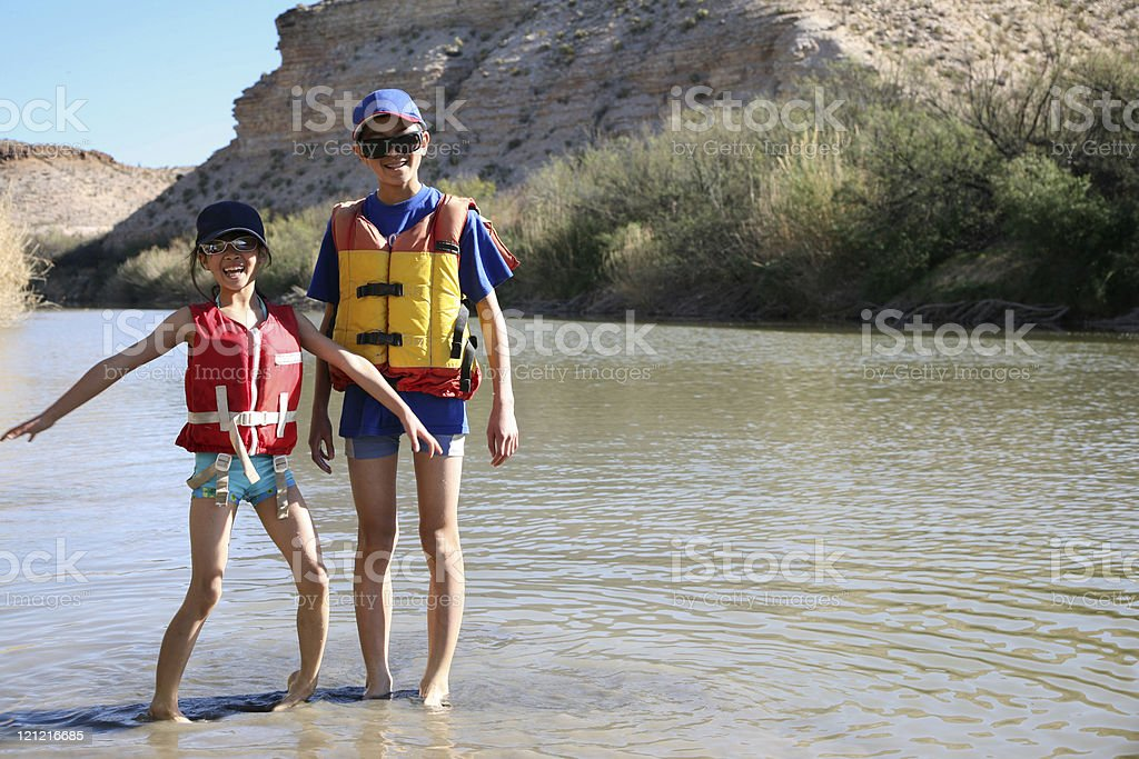 Brother and Sister Playing in River royalty-free stock photo