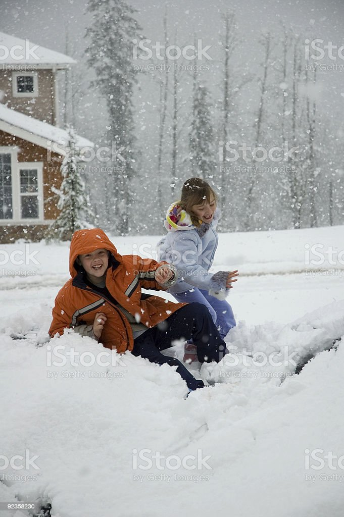 Brother and Sister Playing in Snow royalty-free stock photo