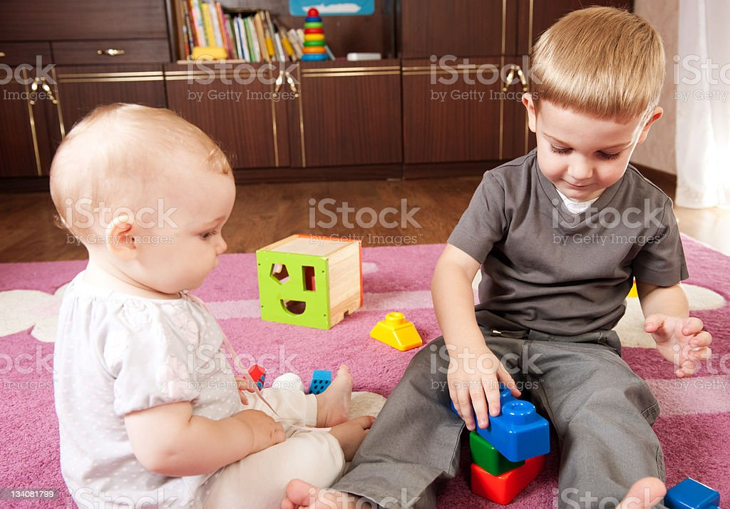 Brother and sister playing royalty-free stock photo