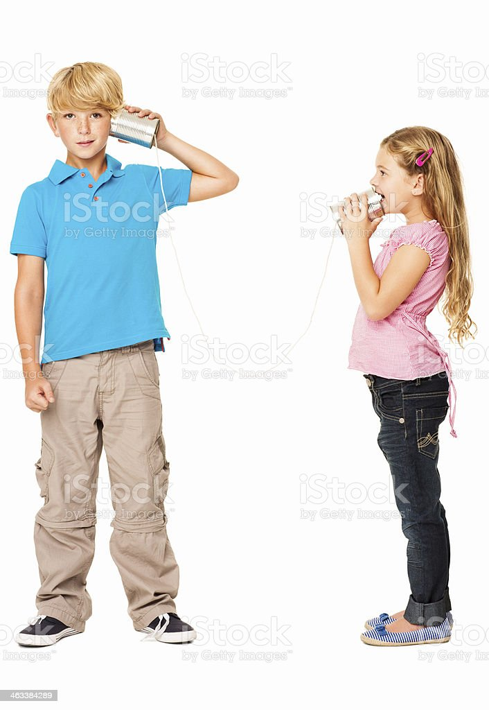 Brother And Sister Playing With Tin Can Phone - Isolated royalty-free stock photo