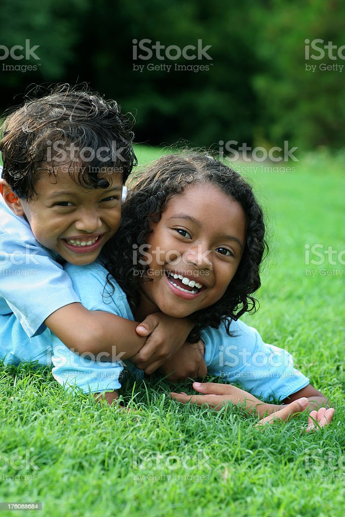 Brother and sister playning in the park royalty-free stock photo