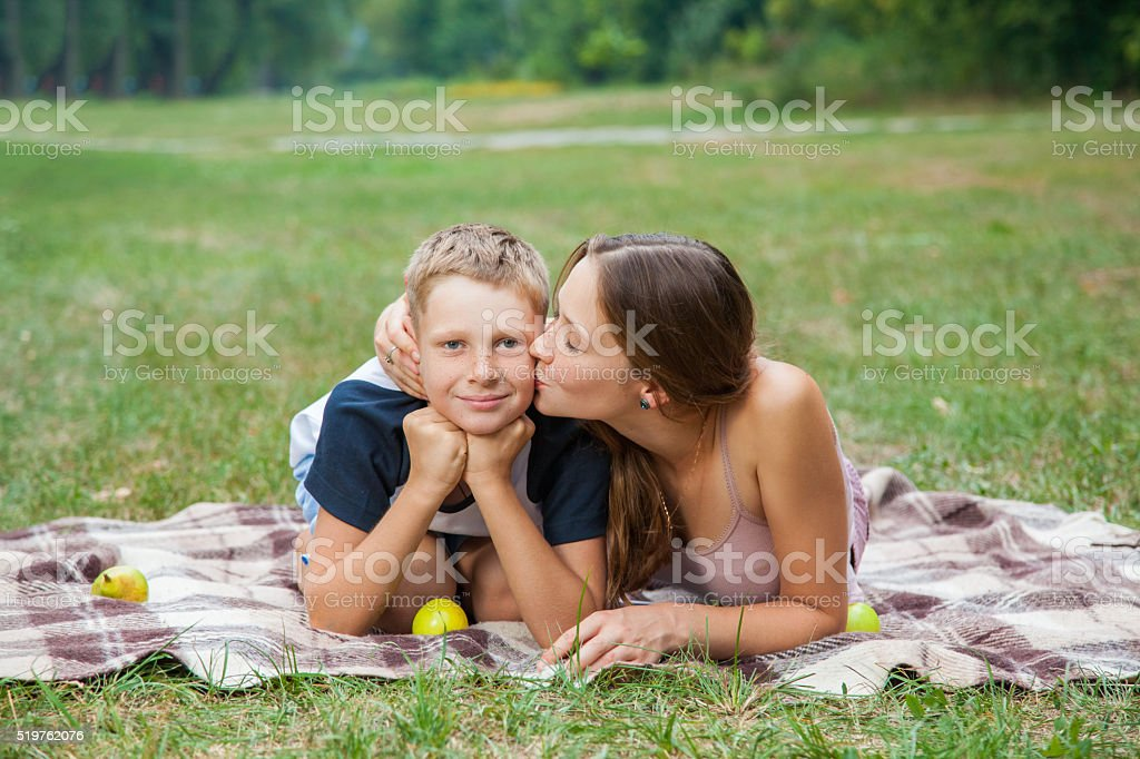 brother and sister resting in the garden. stock photo