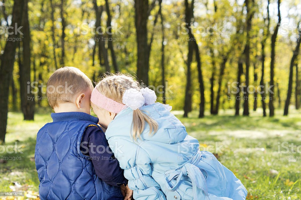 Brother and sister sharing secrets royalty-free stock photo