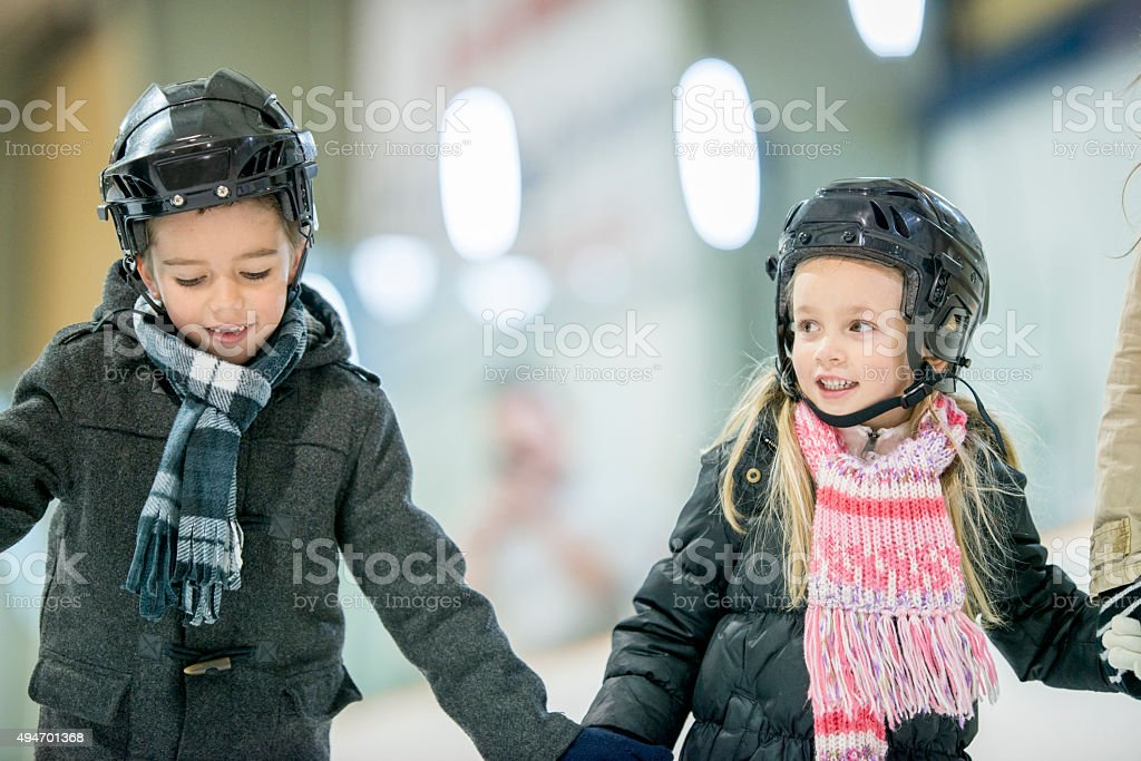 Brother and Sister Skating Together stock photo
