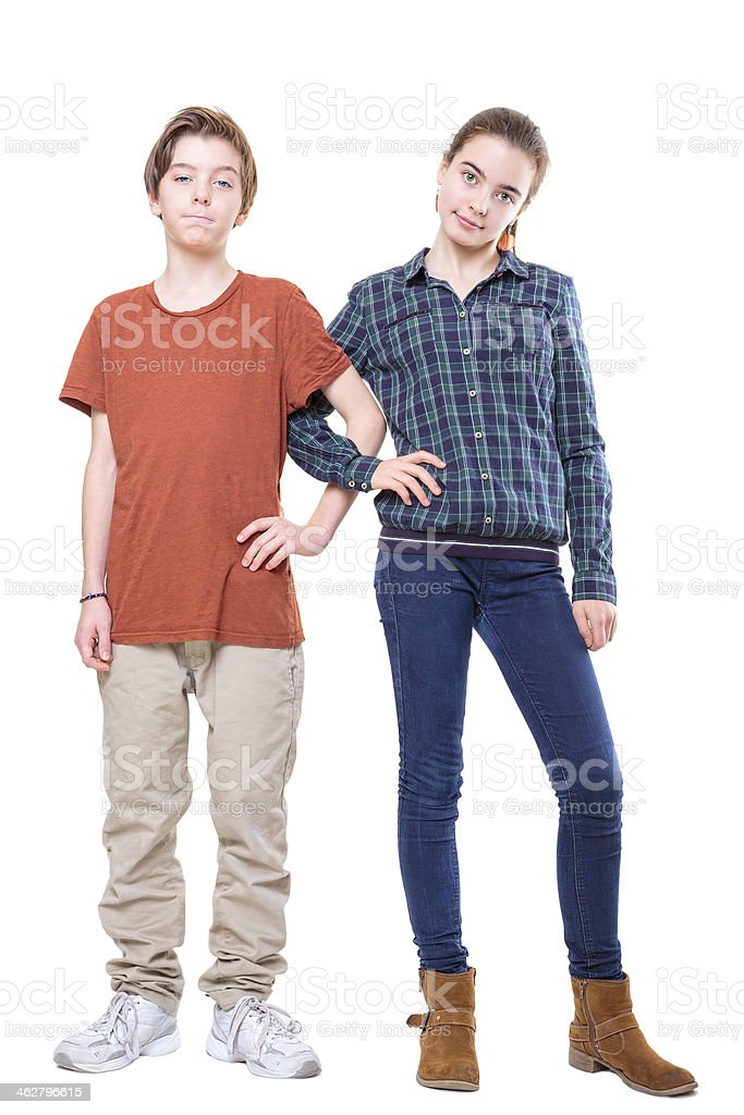 brother and sister standing with linked arms, isolated on white stock photo