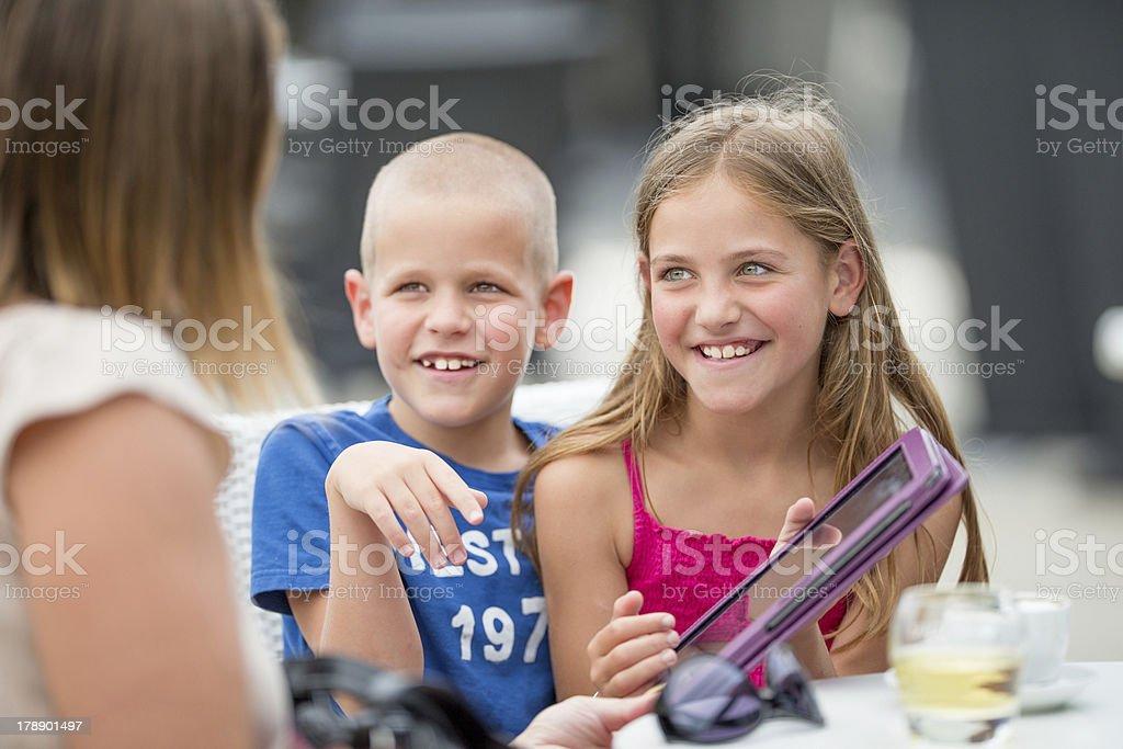 Brother and sister usinga digital tablet royalty-free stock photo