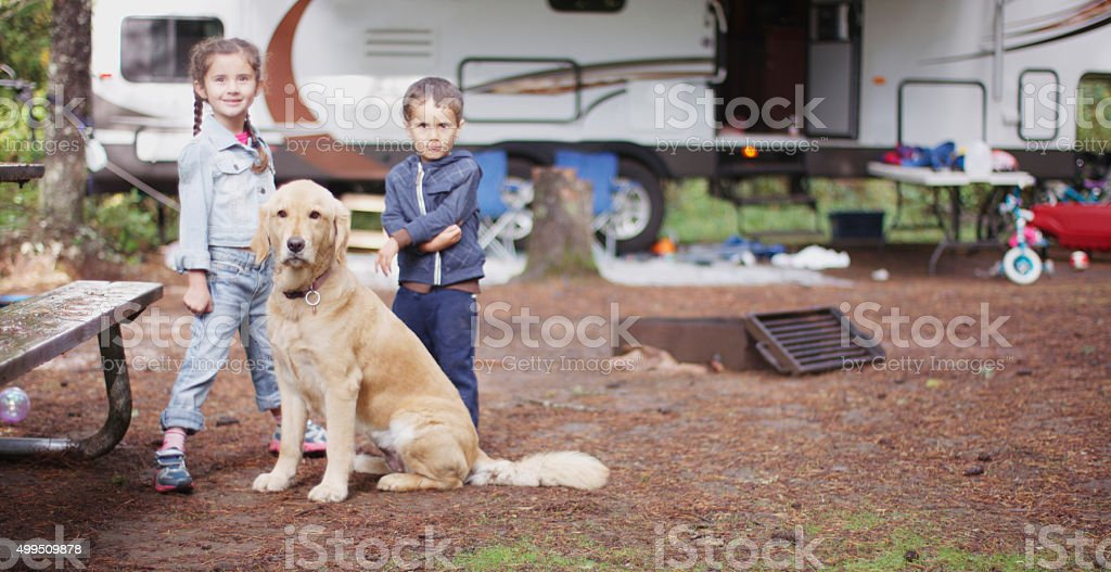 Brother and Sister with Their Dog stock photo