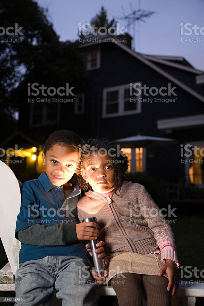 Brother and sister with torch on halloween stock photo