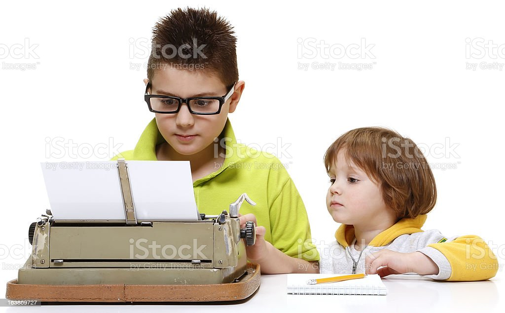 Brother and sister work on typing machine royalty-free stock photo