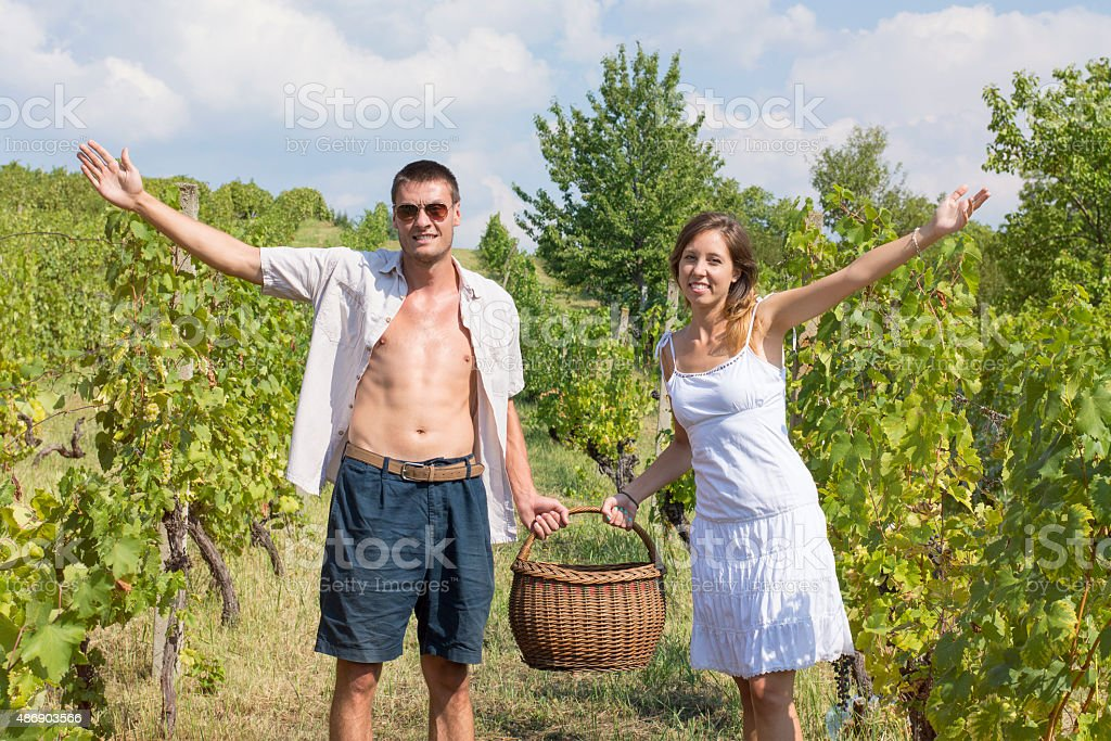 Brother and sister working on grape picking stock photo
