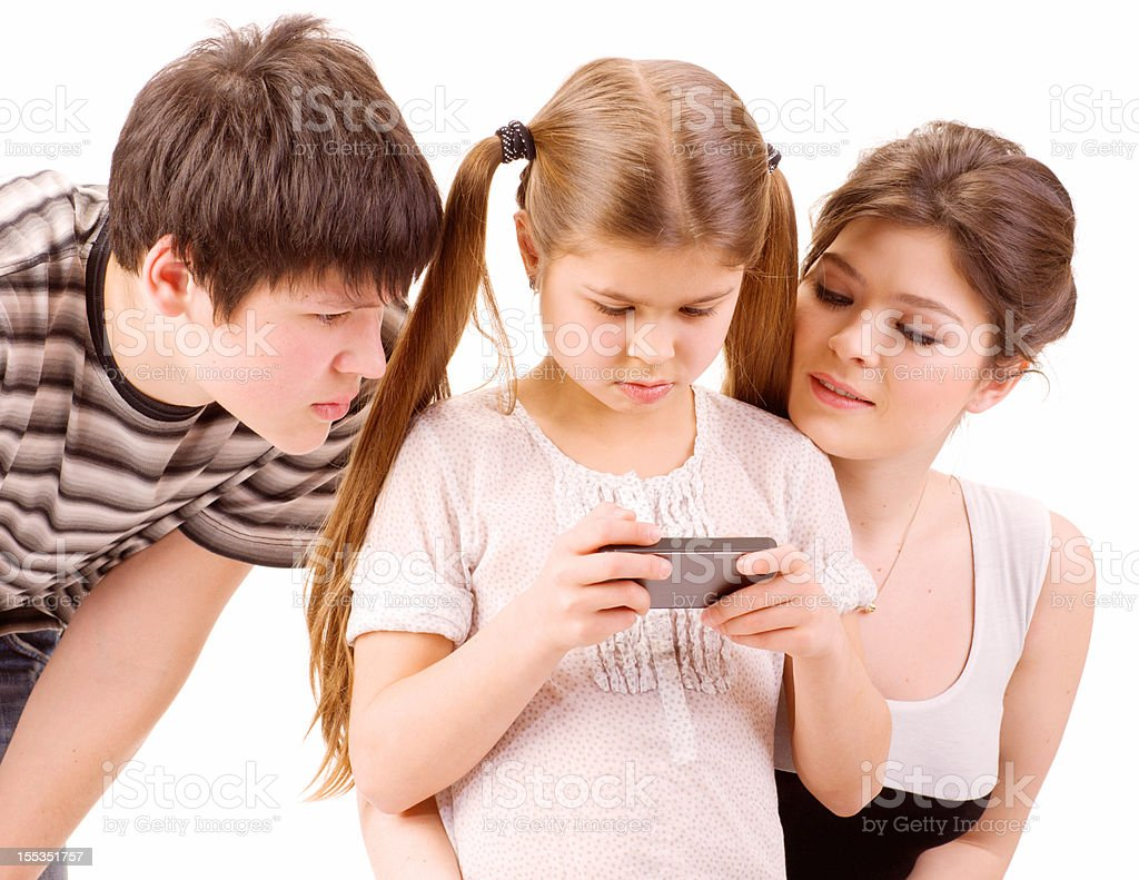 Brother and Sisters playing mobile games royalty-free stock photo