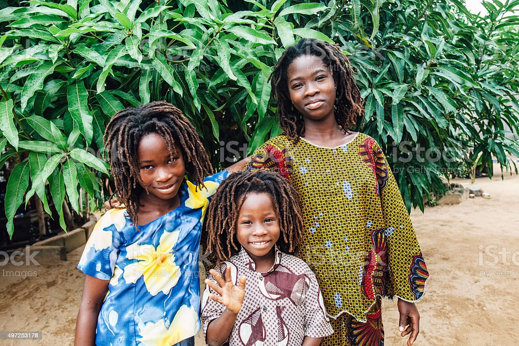 Brother and sisters. West Africa. stock photo