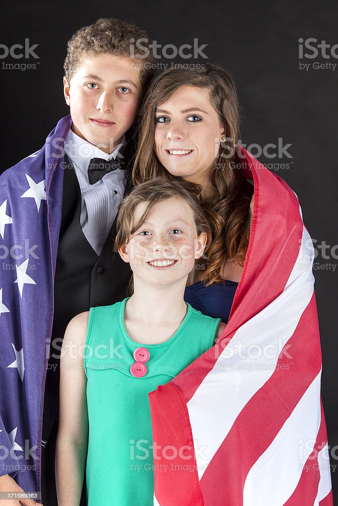Brother And Sisters Wrapped In The Stars & Stripes royalty-free stock photo