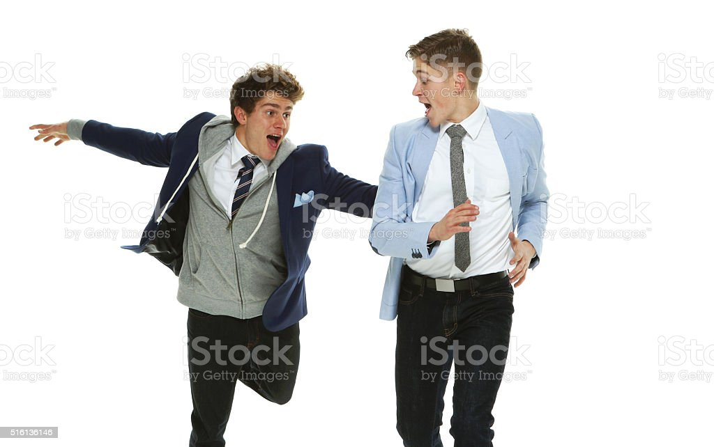 Brother chasing each other running stock photo