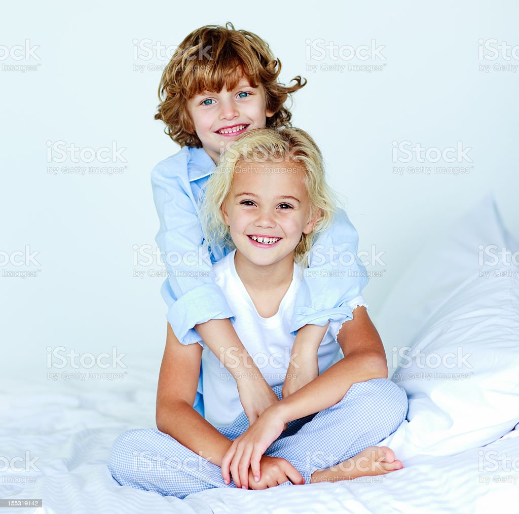 Brother hugging his sister saying good night royalty-free stock photo