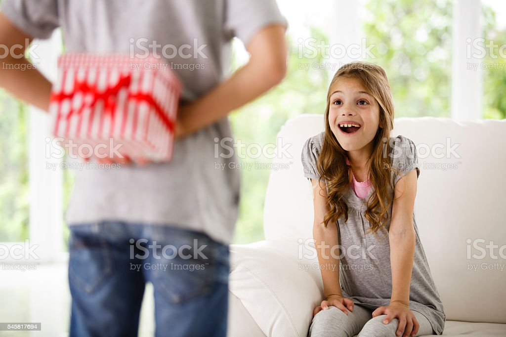 Brother is bringing present for his sister stock photo
