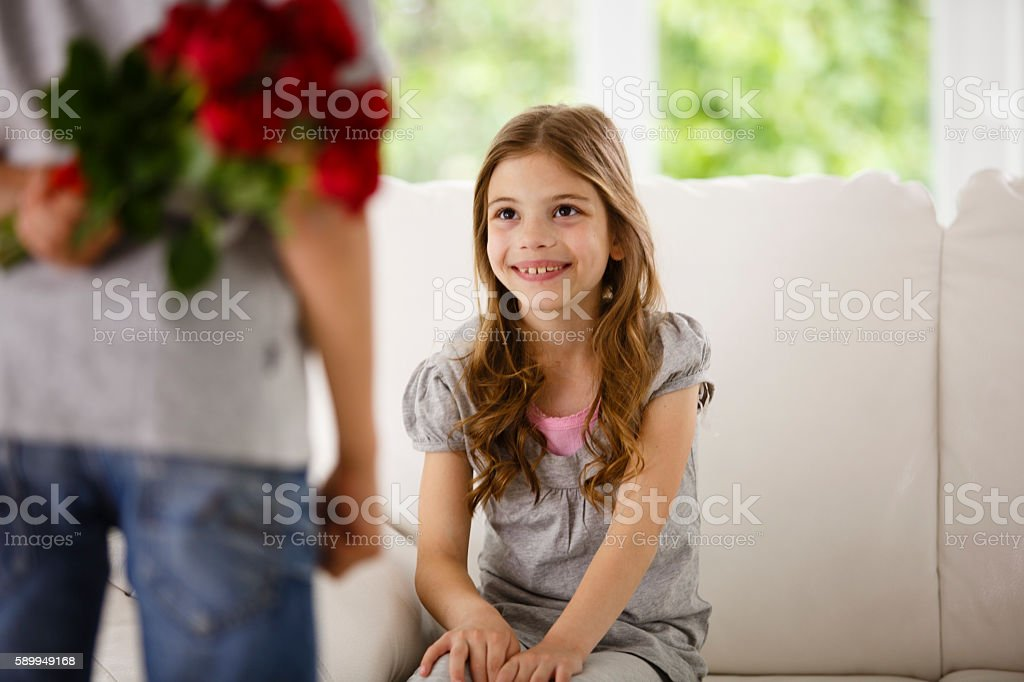 Brother is bringing roses for his sister stock photo