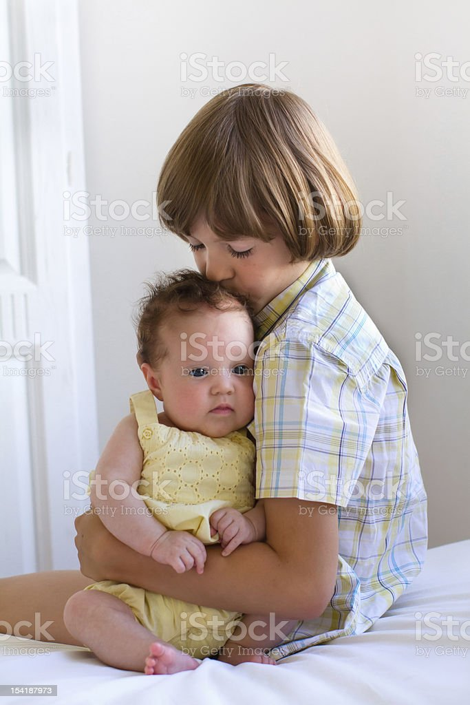 Brother kissing baby sister royalty-free stock photo