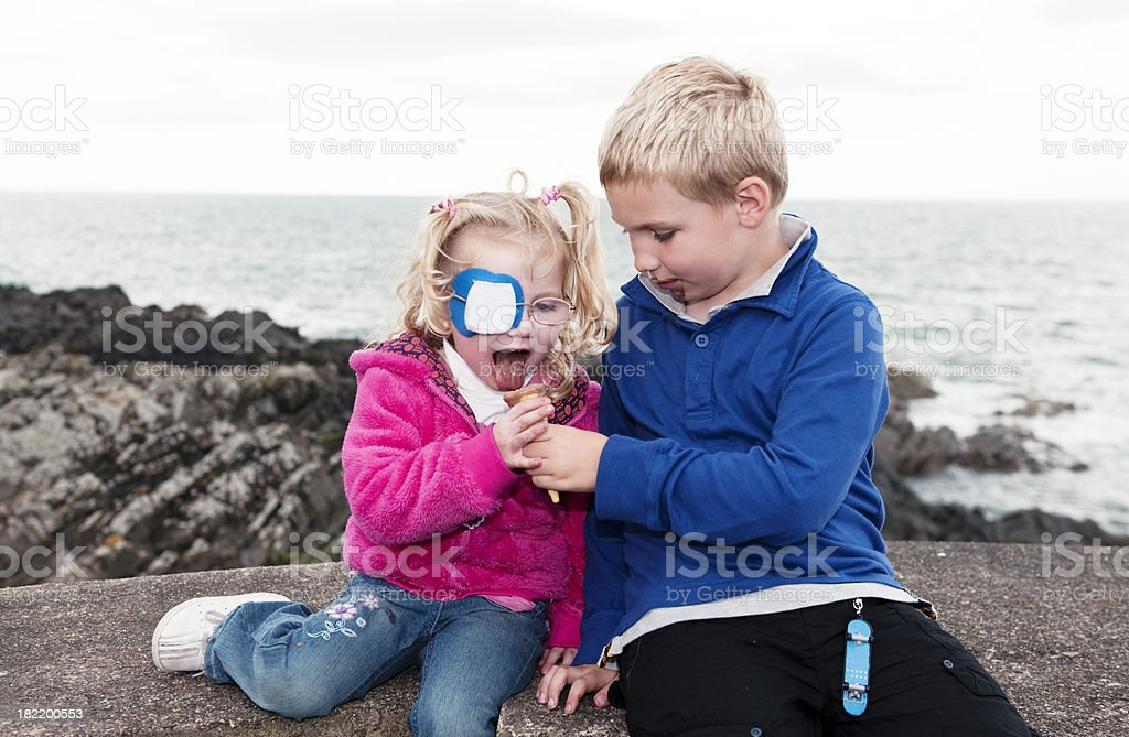 brother sharing ice cream with his sister royalty-free stock photo