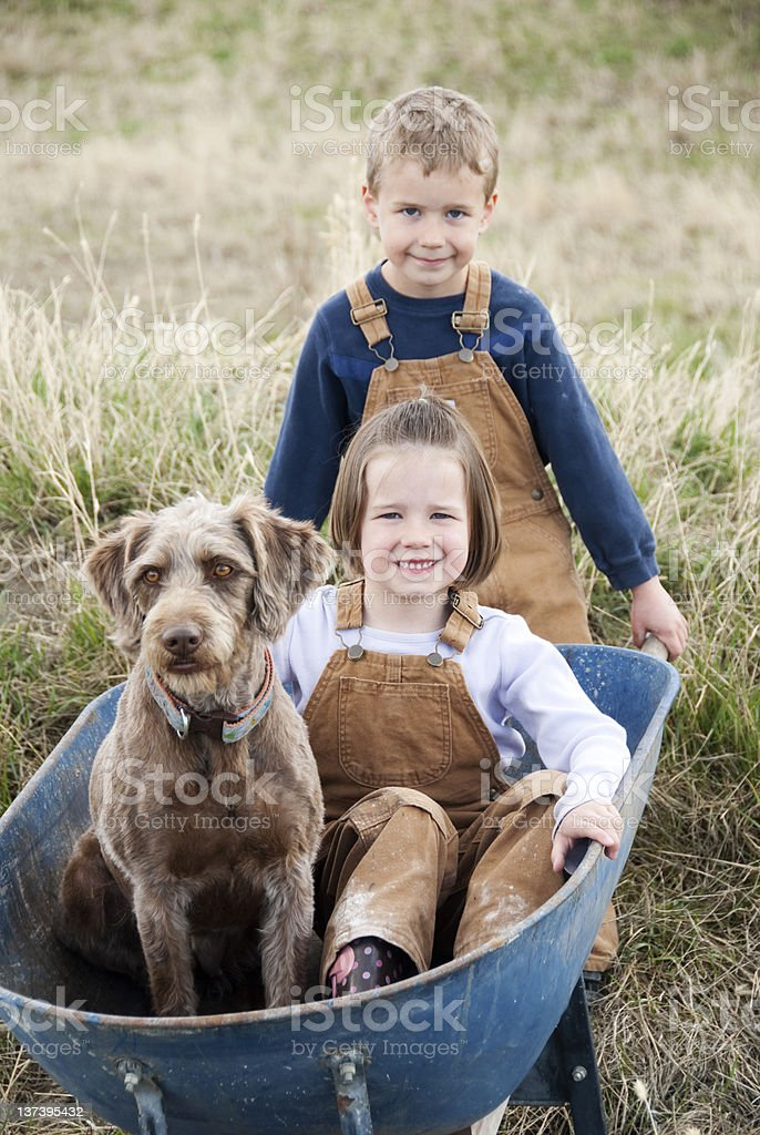 Brother & Sister with their Pet stock photo