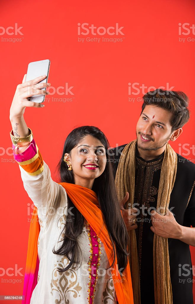brother taking selfie with sister on raksha bandhan festival stock photo