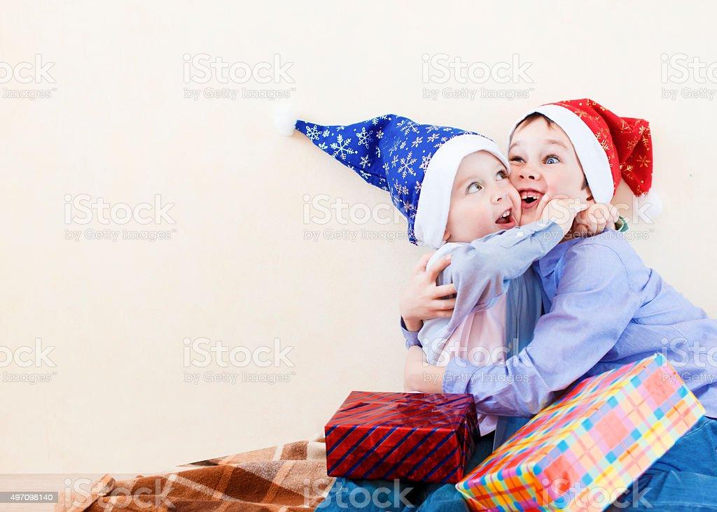 brotherly hugs at Christmas stock photo