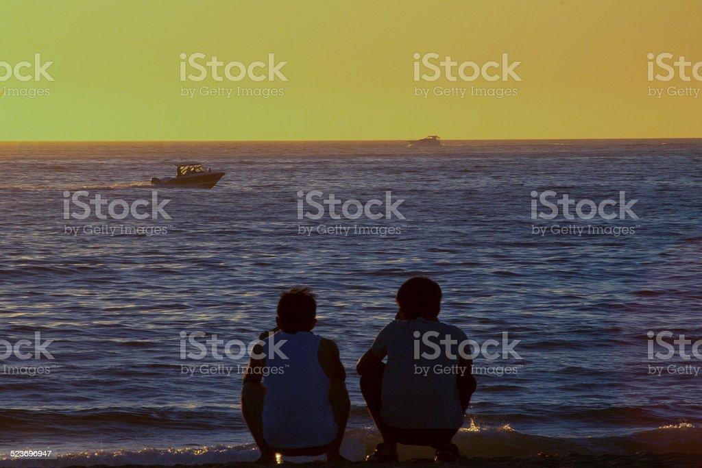 Brotherly Moment at Dusk stock photo