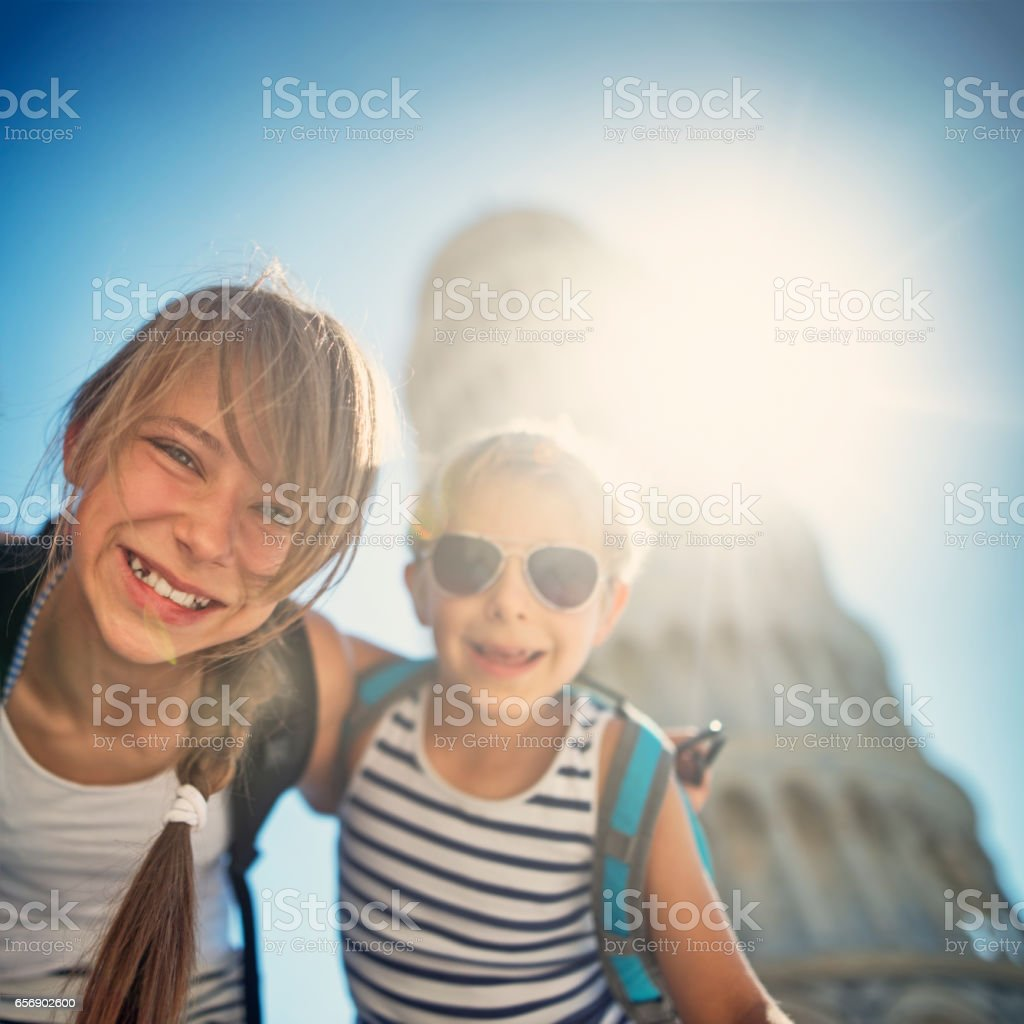 Brothers and sister having fun in Pisa stock photo