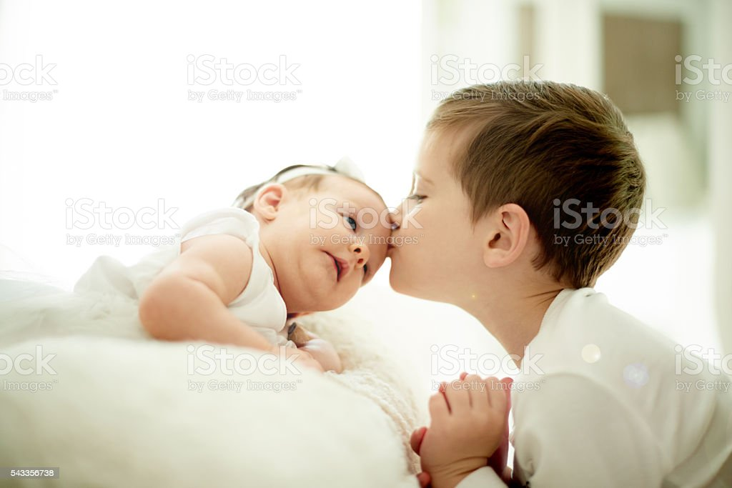 Brothers and sisters have that forever kind of love stock photo
