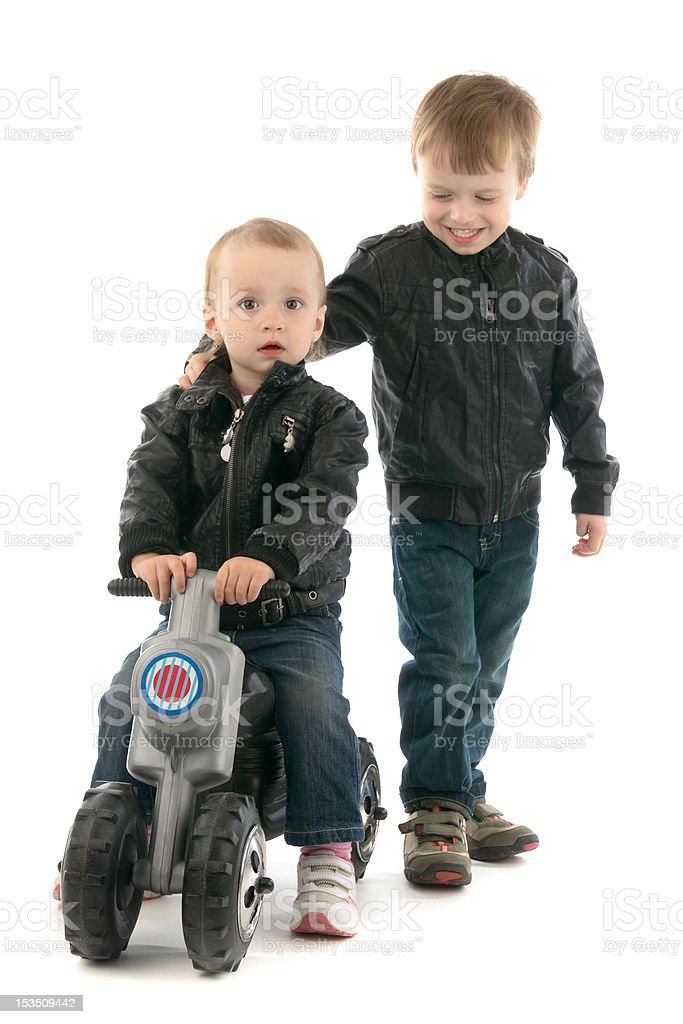 Brothers and sisters with motorcycle royalty-free stock photo