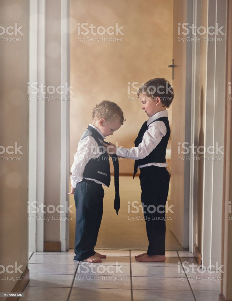 Brothers are there to help each other stock photo