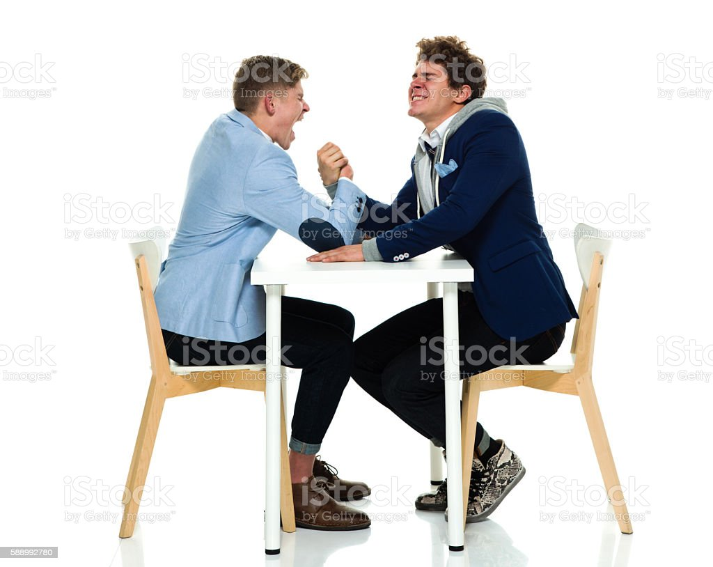 Brothers arm wrestling stock photo