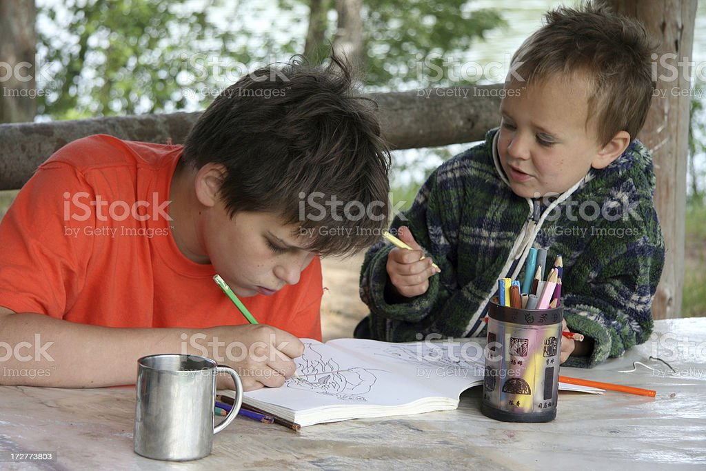Brothers draw royalty-free stock photo