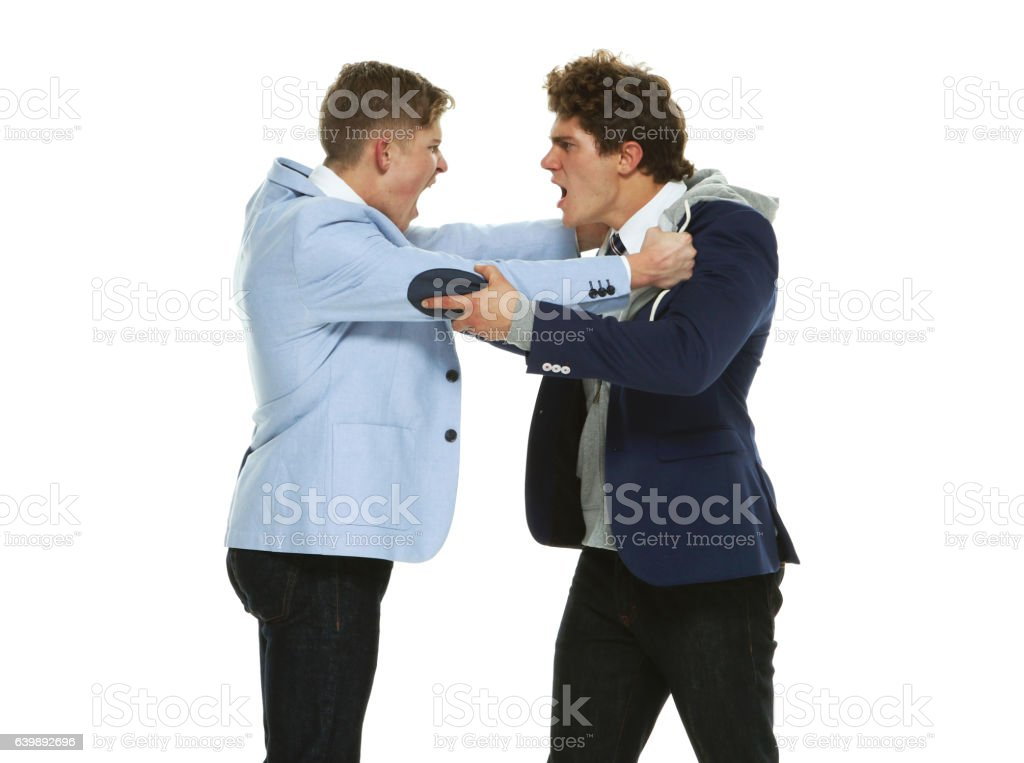 Brothers fighting stock photo