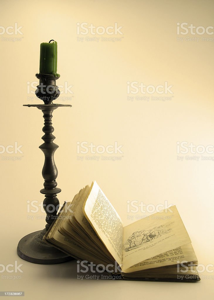 Brothers Grimm Book and Candle stock photo