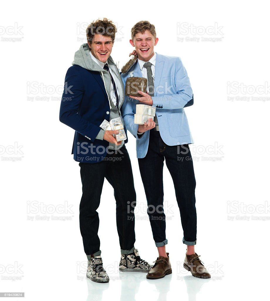 Brothers holding money and drug stock photo