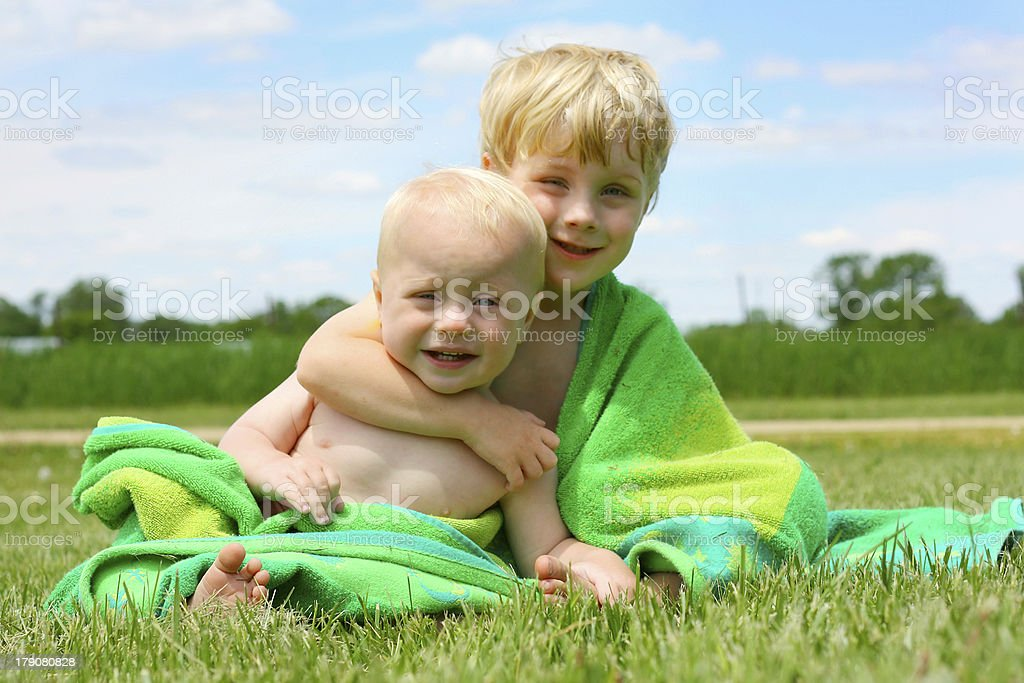 Brothers Hugging in Beach Towel royalty-free stock photo