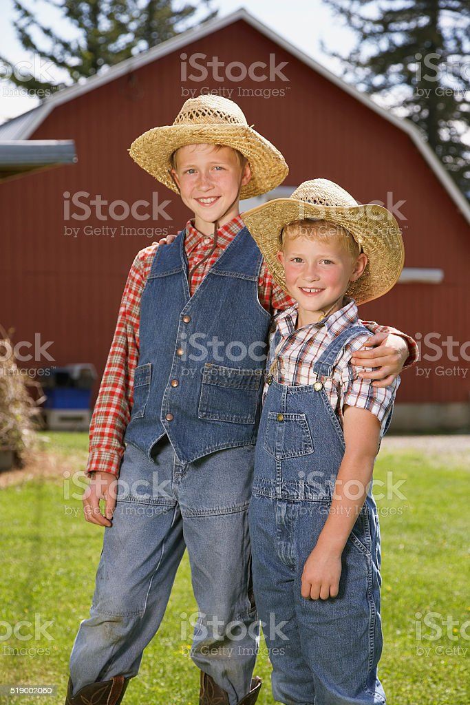 Brothers in front of barn stock photo