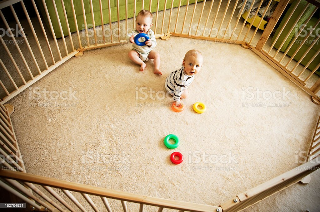 Brothers in play pen stock photo