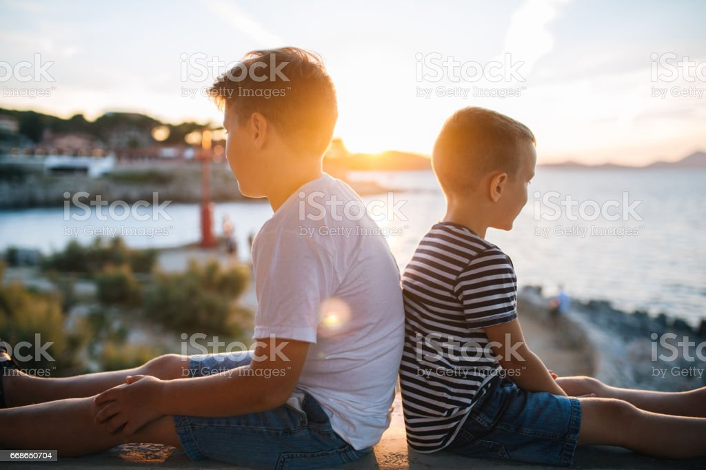 Brothers in the sunset stock photo