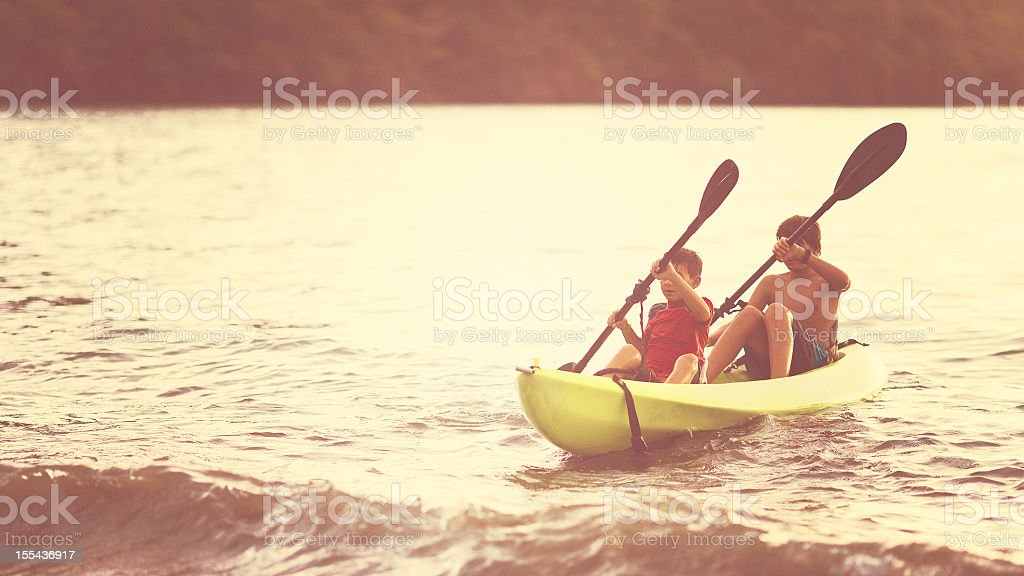 brothers kayaking royalty-free stock photo