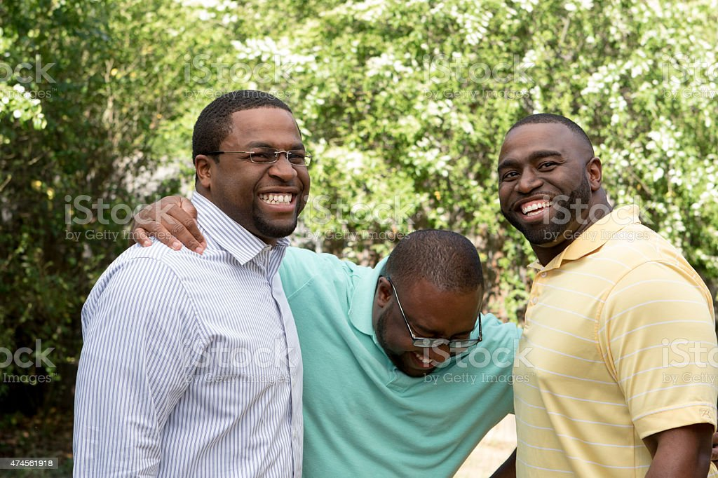 Brothers laughing and talking stock photo