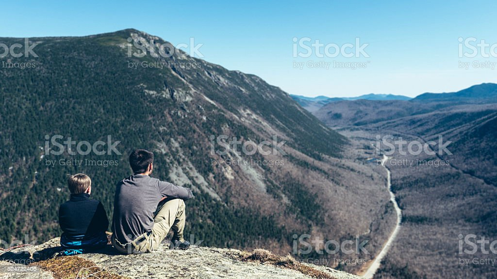 Brothers overlooking Crawford Notch in New Hampshire stock photo
