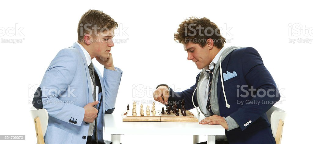 Brothers playing chess stock photo