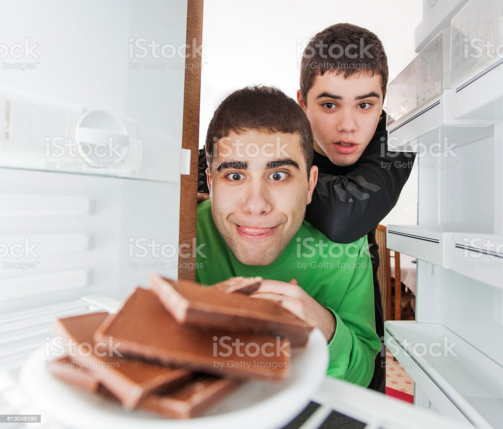 Brothers stealing chocolate stock photo