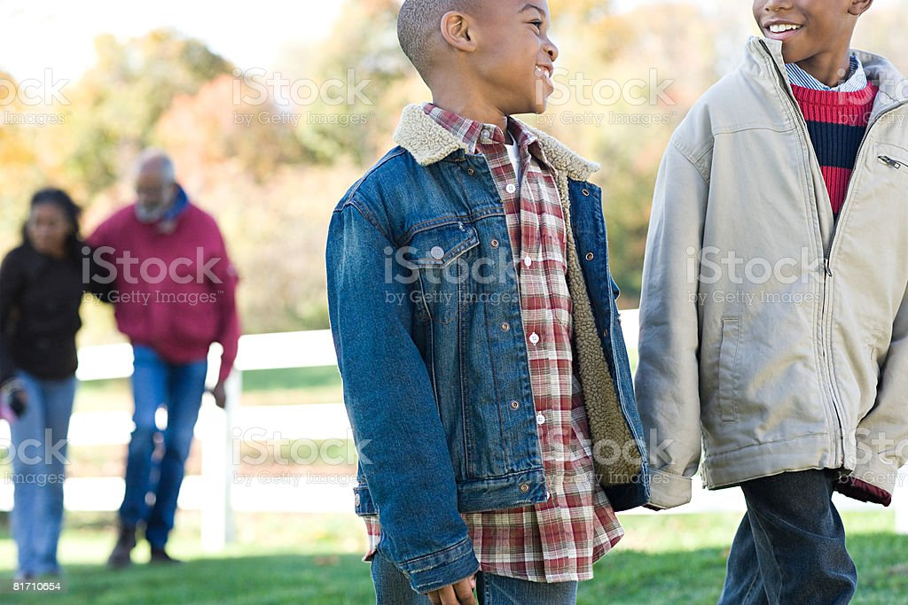 Brothers walking royalty-free stock photo