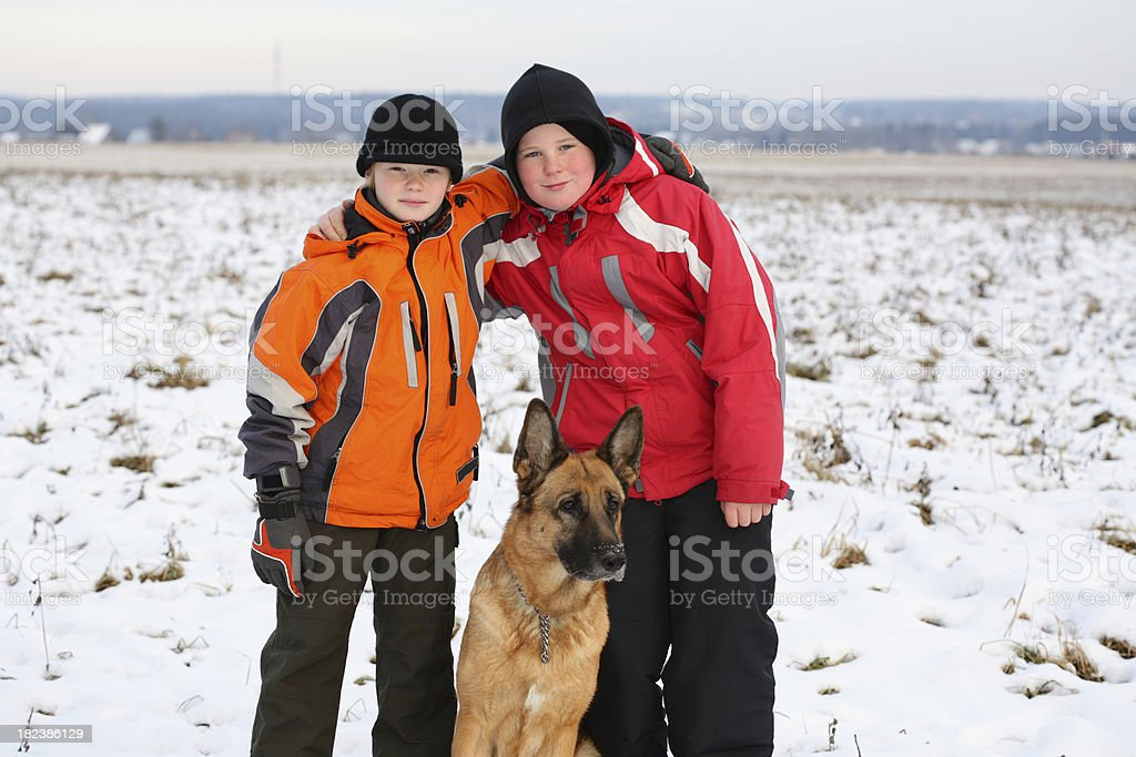 Brothers with dog royalty-free stock photo