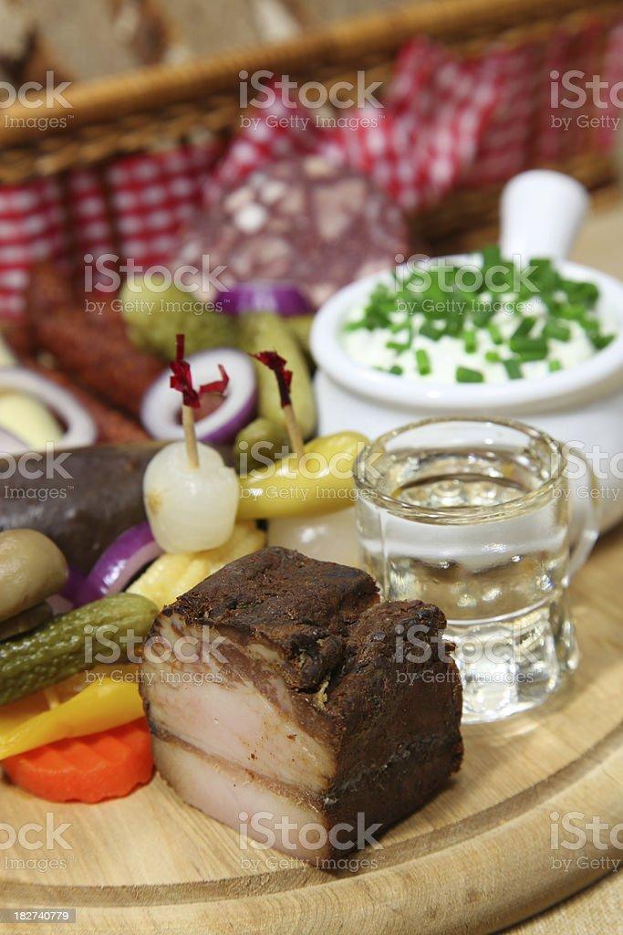 Brotzeit snack Plate with Shot stock photo