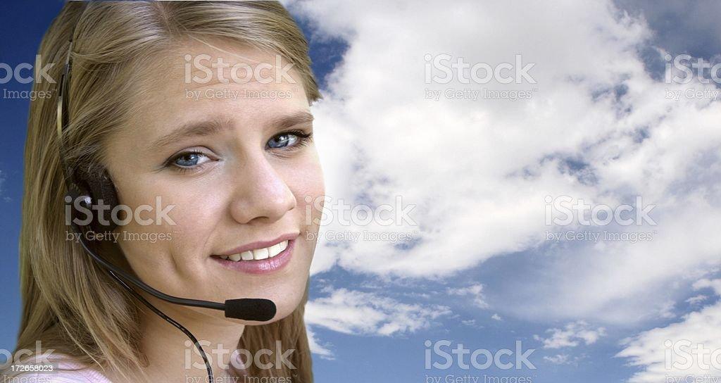 Brow Raised, Headset Woman w/Blue Sky stock photo