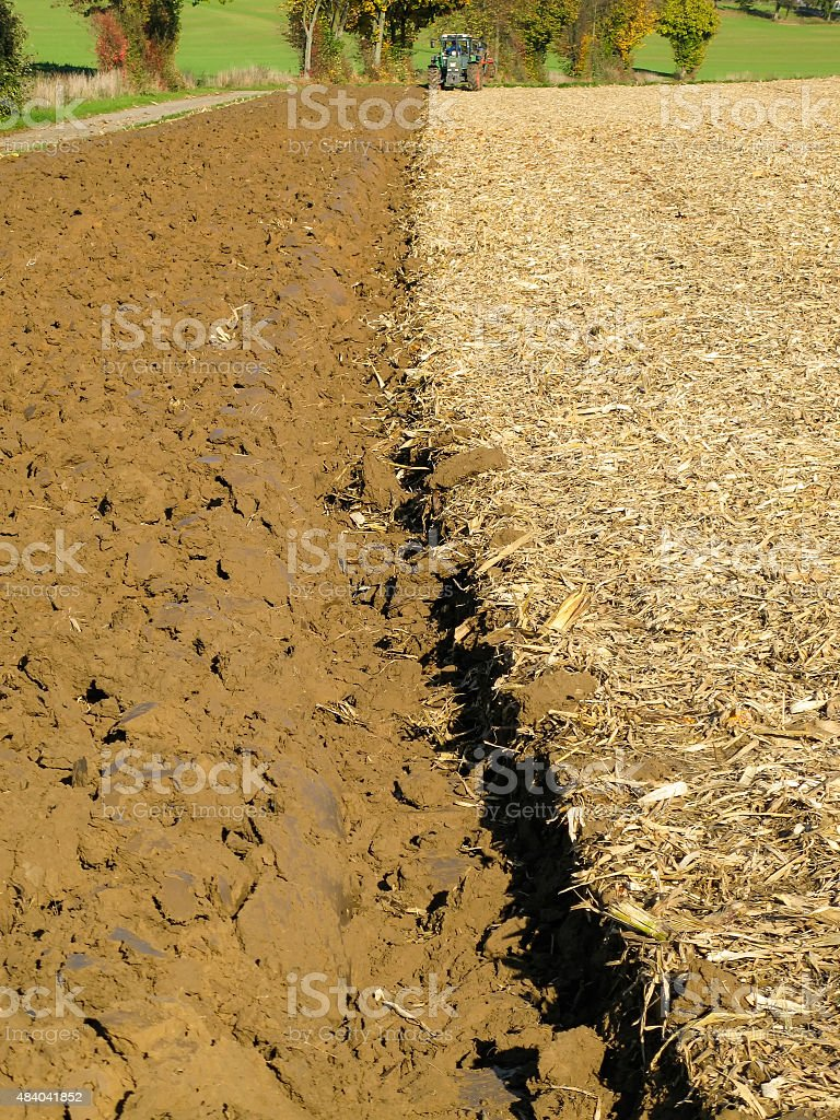 Brown Acre with Tractor stock photo